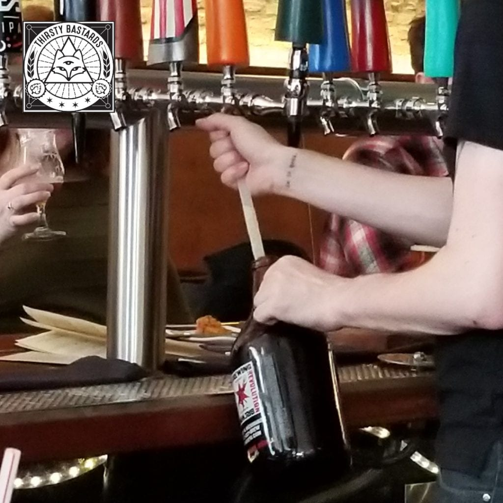 Using a tube from the tapper to fill a growler