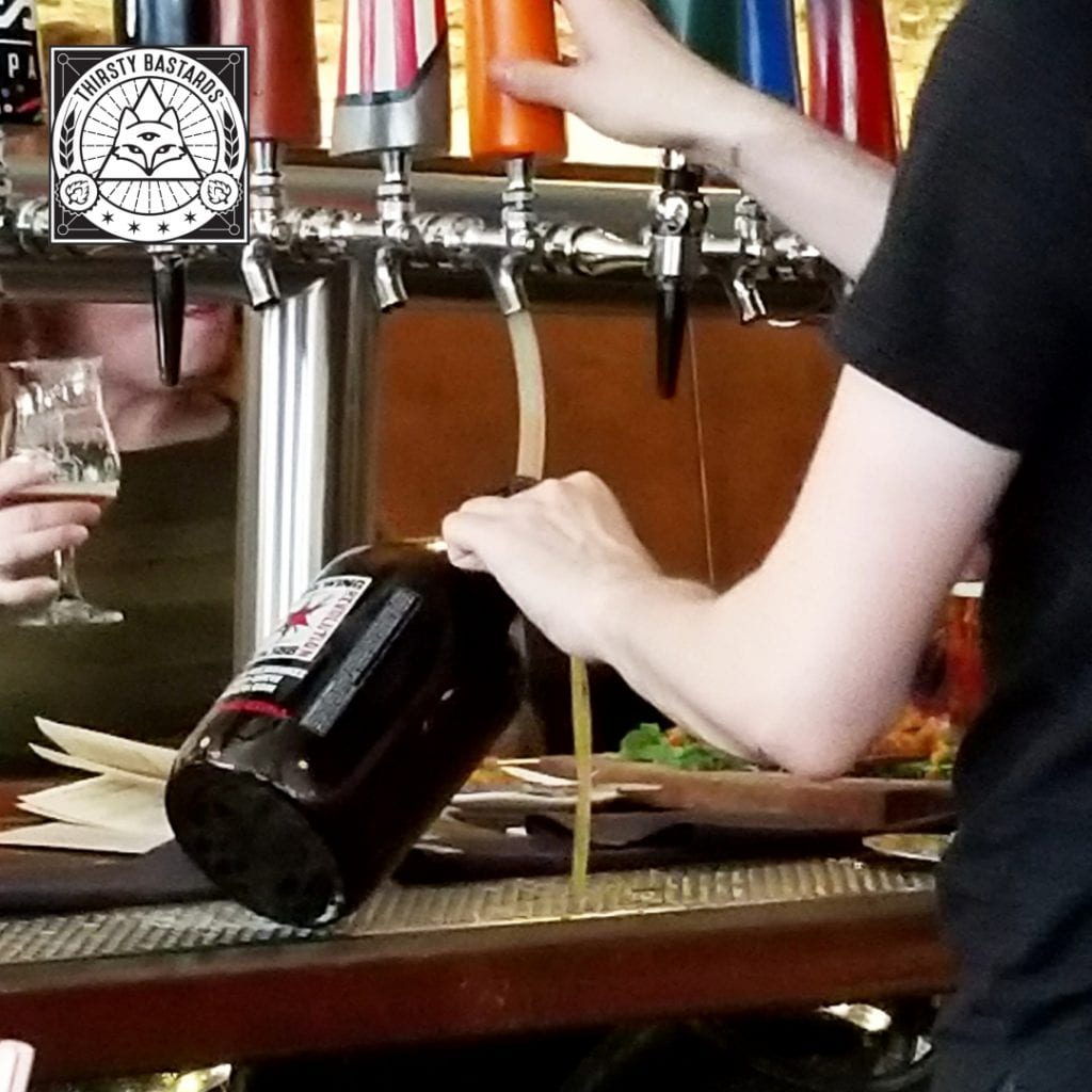 Letting some beer flow out of the growler while it fills
